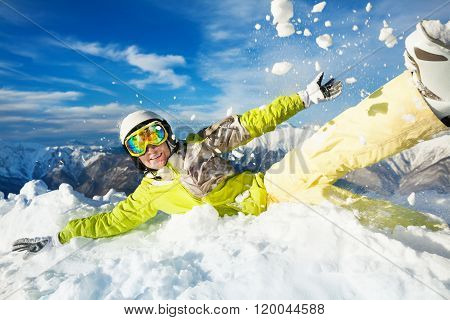 Happy skier woman jump in and throw snow