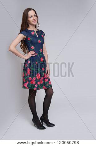 Full Length Of Beautiful Female Posing In Dress
