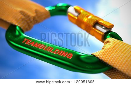 Green Carabiner with Text Teambuilding.