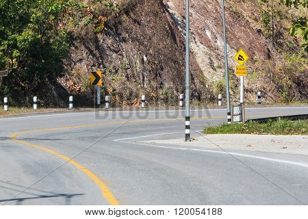 Curved And Steep Downhill Road