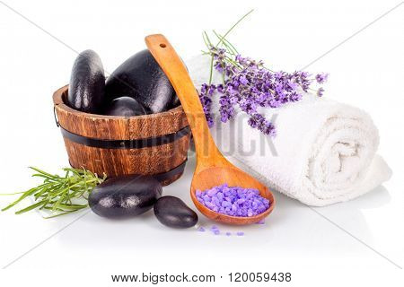 Spa still life with black stone and lavender salt isolated on white background