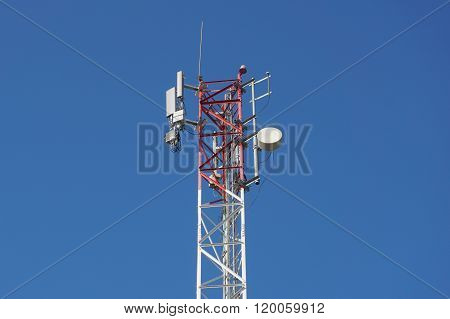 Telecommunication tower on blue sky. Global infrastructure