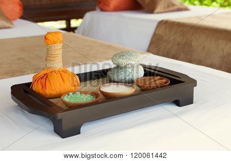 Spa and wellness massage setting Still life with essential oil, salt Outdoor summer background