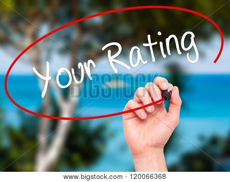 Man Hand Writing Your Rating With Black Marker On Visual Screen.
