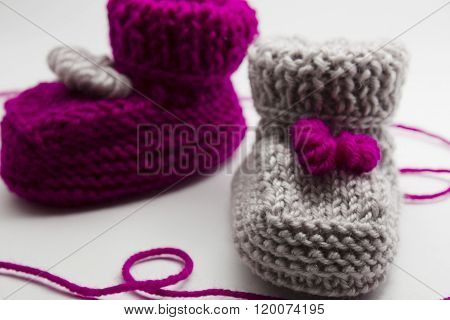 Couple Knitted Bootees To Newborn