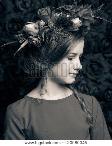 Close Up Portrait Of A Little Cute Girl In A Flower Wreath
