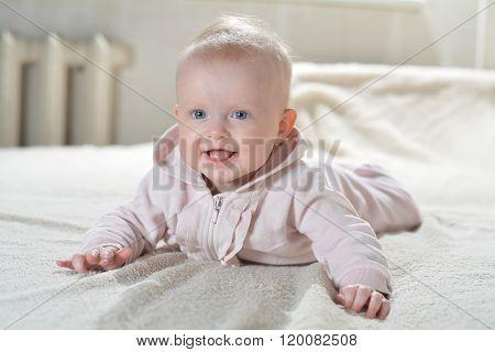 Little Cute Girl In A Bathrobe A White