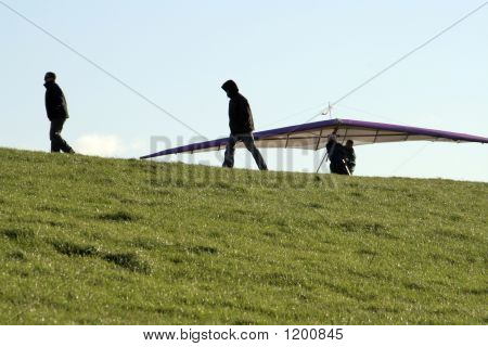 Paragliders On Hillside