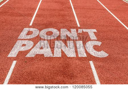 Don't Panic written on running track