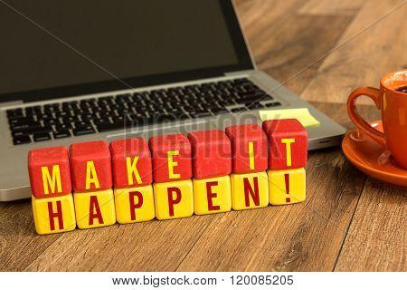 Make It Happen written on a wooden cube in a office desk