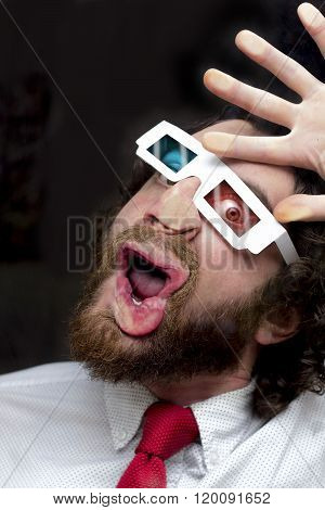 Silly bearded man wearing 3D glasses smooshing face against glass