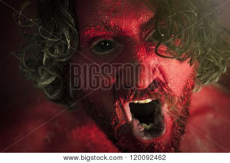 Demon monster man with beard and frightening eyes