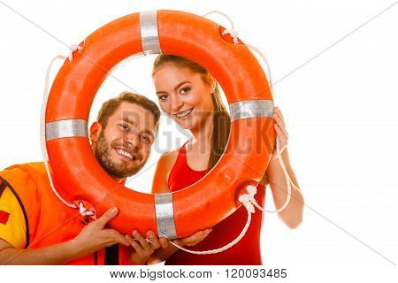 Lifeguards In Life Vest With Ring Buoy Having Fun.