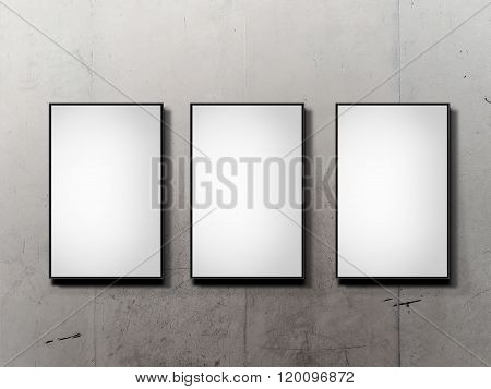 Three blank vertical billboard on wall