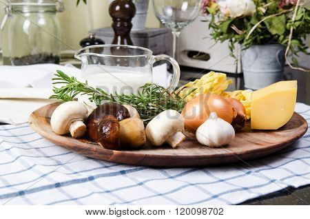 Ingredients pasta tagliatelle  with mushrooms