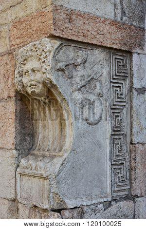 Gorgon Mask And Triton At The Corner Of Corso Borsari Street, Verona