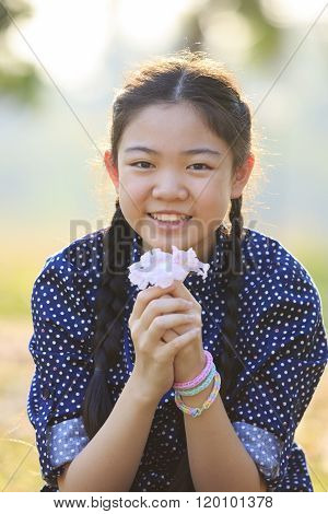 Thai 12S Years Girl Sitting On Garden Field With Pink Flowers In Hand Toothy Smiling Face Happiness