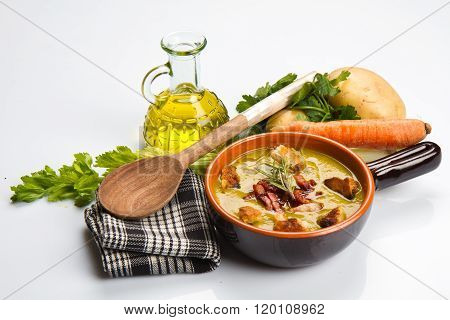 Vegetables soup with fresh vegetables all around the bowl