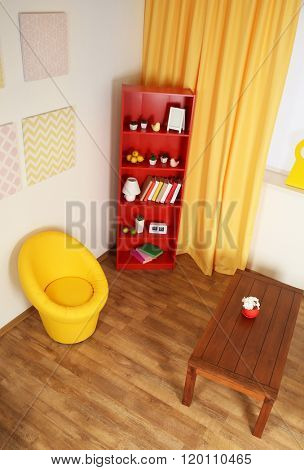 Modern living room interior with red bookcase and yellow chair