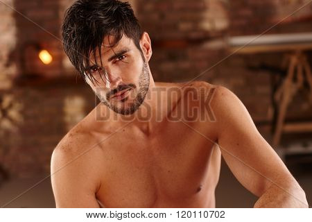 Portrait of handsome young man with bare chest.