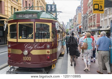 People boarding a tram in Melbourne