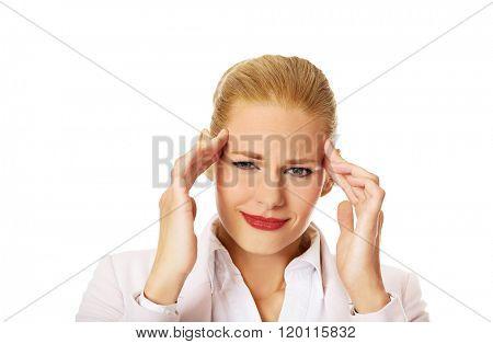 Business woman wtih huge head ache