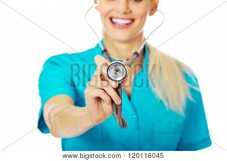 Smile female doctor or nurse uses stethoscope
