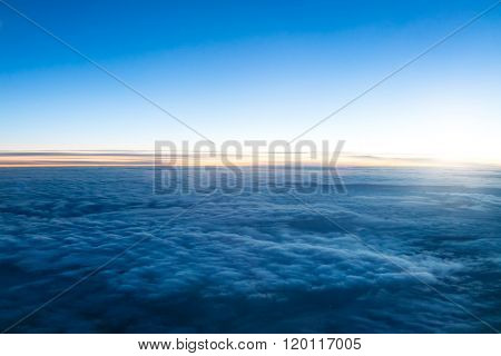 Beautiful dark sunset above clouds