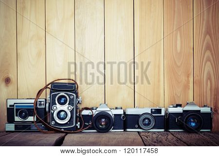 Retro Film Cameras On Wood Background With Free Copy Space, Vintage Background.