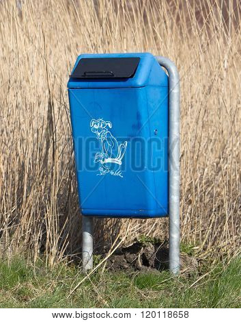 Close Up Of Bright Blue Dog Mess Poop Bin