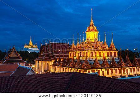 Wat Ratchanaddaram And Loha Prasat Metal Castle At Dusk, Bangkok ,thailand.