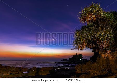 Tanah Lot and sea waves in twilight Bali Indonesia.