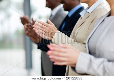 business group applauding during meeting presentation