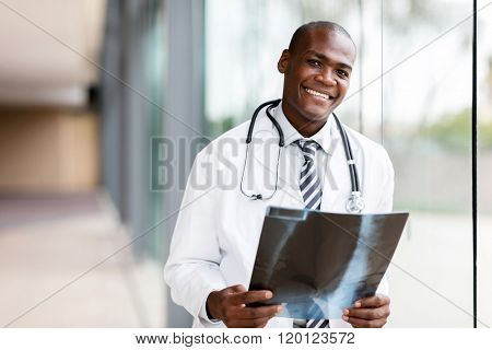 portrait young african medical doctor holding patient's x-ray