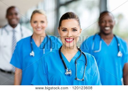 pretty medical nurse and colleagues in hospital