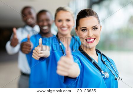 cheerful medical team giving thumbs up