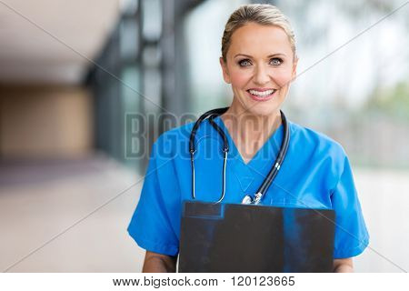 happy female health care worker with x ray