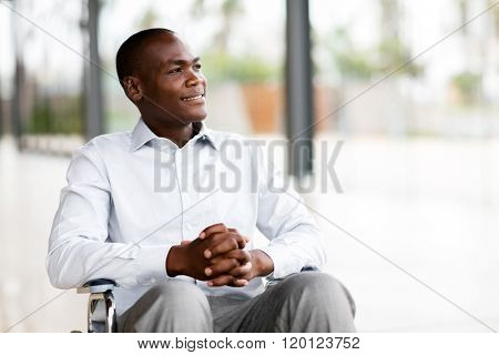 thoughtful disabled man in wheelchair looking way