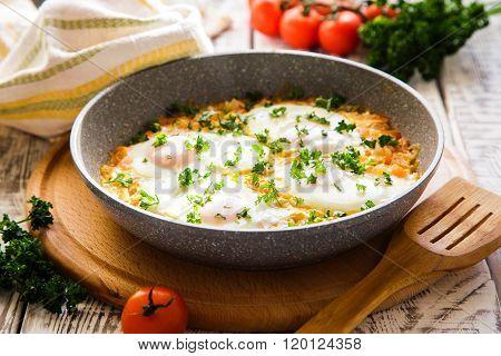 Shakshuka - Traditional Dish Of Israeli Cuisine In A Skillet