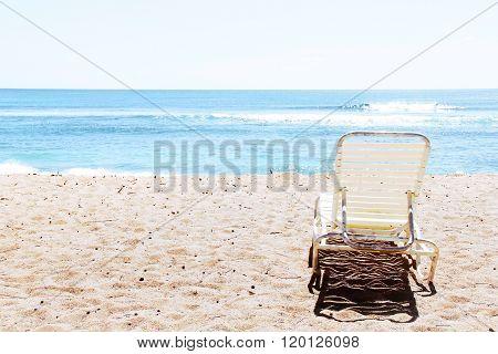 chair on the beach with summer sunlight at Kauai, Hawaii