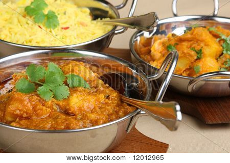Indian chicken dansak with vegetable curry and pilau rice.