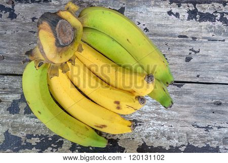 A banch of bananas on wooden vintage table