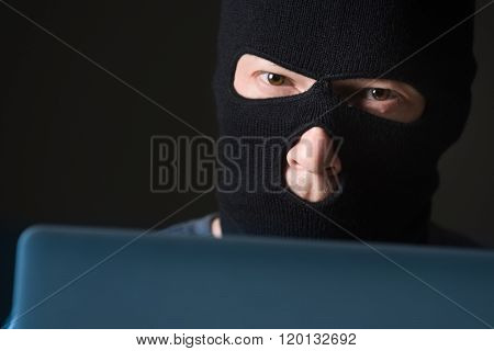 Hacker in a mask