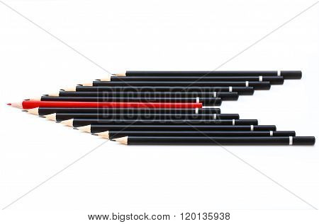 Black pencils with a red one in the middle