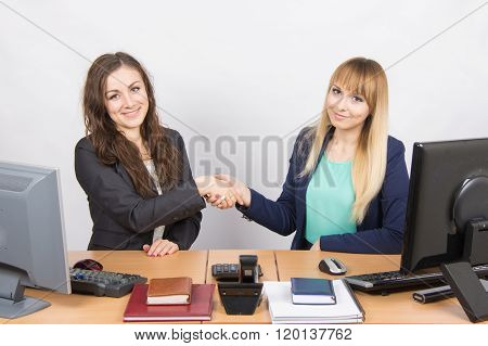 Two Young Girls Acquainted Shake Hands And Looked Into The Frame