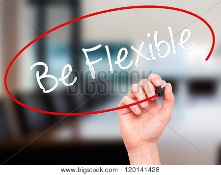 Man Hand Writing Be Flexible With Black Marker On Visual Screen.