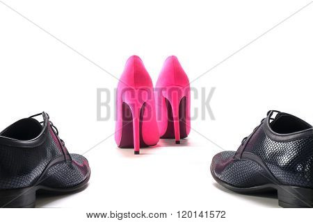 Black Men's Shoes Pursue Ladies Pink High Heels From Behind, Concept Of Gender Issues Isolated On Wh