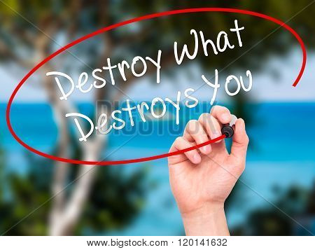 Man Hand Writing Destroy What Destroys You With Black Marker On Visual Screen.
