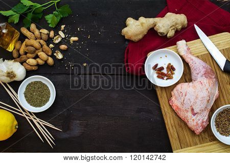 Raw Chicken Leg With Ingredients On Dark Wood, View From Above, Cooking Asian Satay With Peanut Sauc