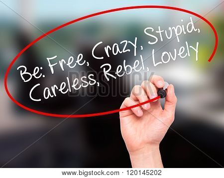 Man Hand Writing Be: Free, Crazy, Stupid, Careless, Rebel, Lovely With Black Marker On Visual Screen